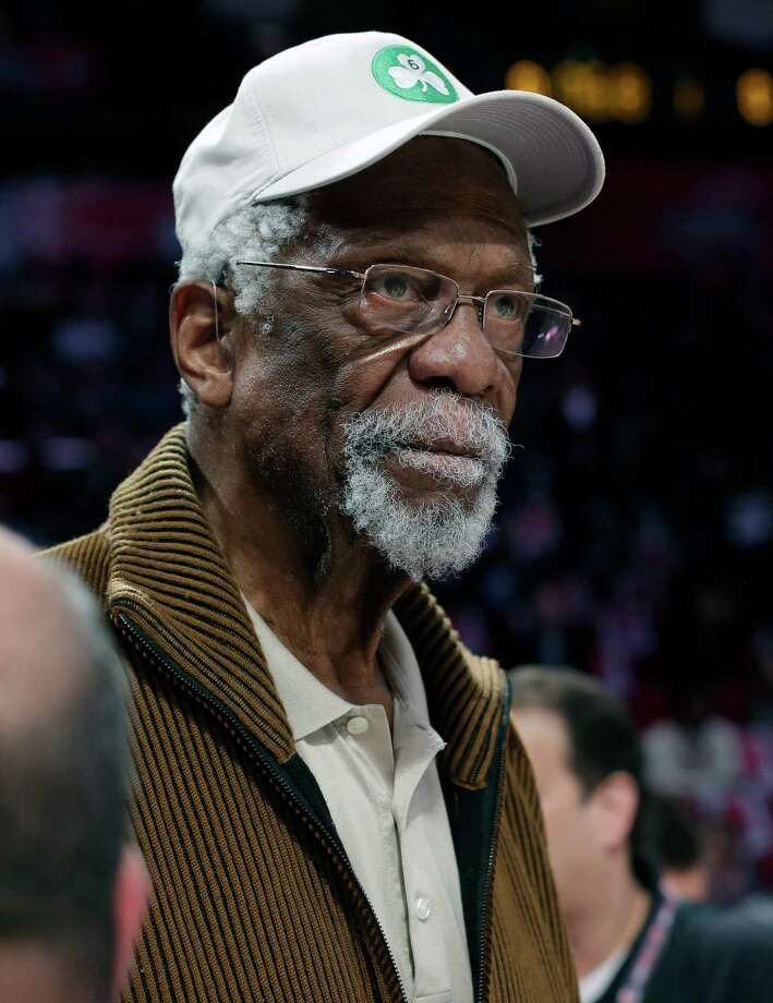 FILE - IN this Feb. 16, 2013, file photo, former Boston Celtis' Bill Russell watches the NBA All-Star Saturday Night basketball competition in Houston. Celtics officials say the NBA Hall of Famer is doing OK after collapsing during a speaking engagement near Lake Tahoe, Nev.,  Thursday, July 17, 2014.  (AP Photo/Eric Gay, File) ORG XMIT: NY155 Photo: Eric Gay / AP