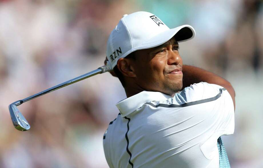 Tiger Woods of the US plays a shot off the 4th tee during the first day of the British Open Golf championship at the Royal Liverpool golf club, Hoylake, England, Thursday July 17, 2014. (AP Photo/Peter Morrison) ORG XMIT: HOY171 Photo: Peter Morrison / AP