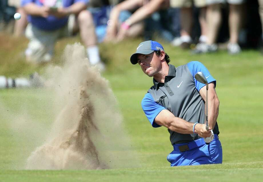 Rory McIlroy hits from a bunker near the 16th green during the opening round at Royal Liverpool, but second rounds have been his bugaboo this year. Six times in his last eight events, McIlroy has had a nine-hole score of 40 or higher on Friday. Photo: Peter Morrison / Associated Press / AP