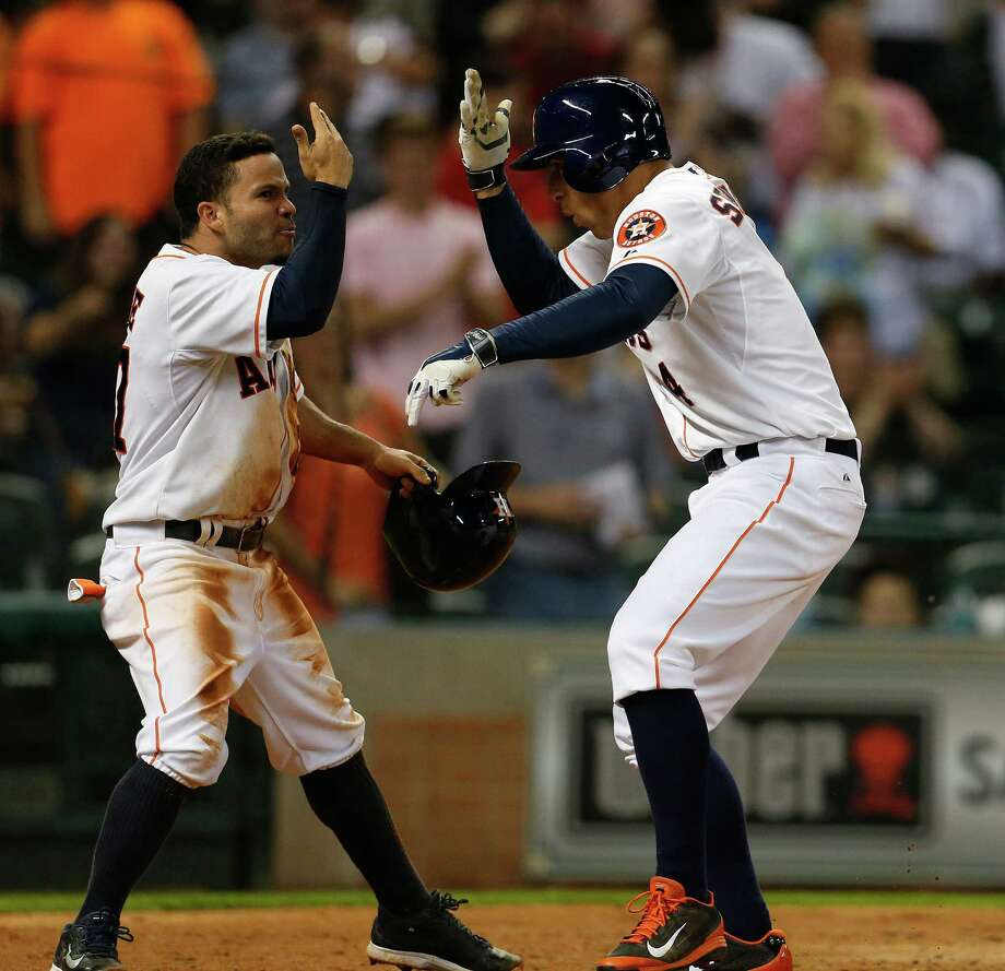 The most fascinating players from this season converge as Jose Altuve, in the running for a batting title, greets George Springer, a rookie who has displayed prodigious power and a propensity for strikeouts. Photo: Karen Warren, Staff / © 2014 Houston Chronicle