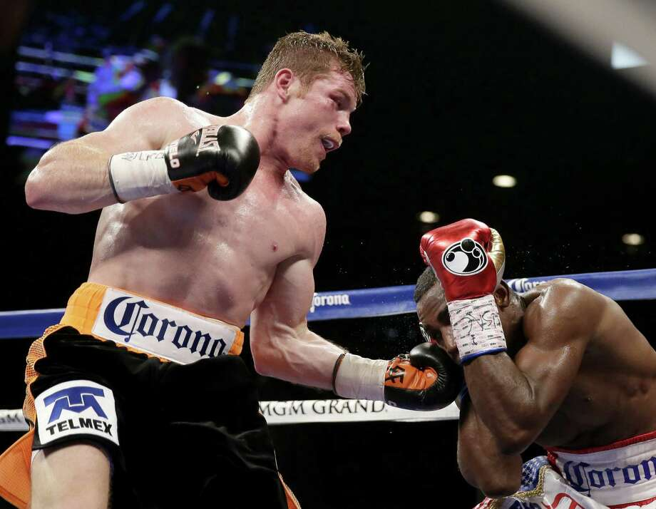 "Saul ""Canelo"" Alvarez (left) defeated Erislandy Lara by split decision Saturday in a bout lacking excitement. ""I'll give him a rematch,"" Alvarez said, ""when he learns how to fight."" Photo: John Locher / Associated Press / AP"