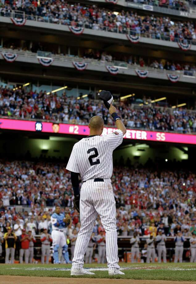 American League shortstop Derek Jeter, of the New York Yankees, waves as he is taken out of the game in the top of the fourth inning of the MLB All-Star baseball game, Tuesday, July 15, 2014, in Minneapolis. (AP Photo/Jeff Roberson) ORG XMIT: MNCN270 Photo: Jeff Roberson / AP