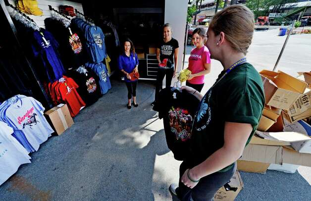 Sales associates Sara Connor, left, Chrissy Iwan, second from left, Leah Carter and Mariah Linnett stock shelves of their store on track Thursday morning, July 17, 2014, at Saratoga Race Course in Saratoga Springs, N.Y.  (Skip Dickstein / Times Union) Photo: SKIP DICKSTEIN / 00027702A