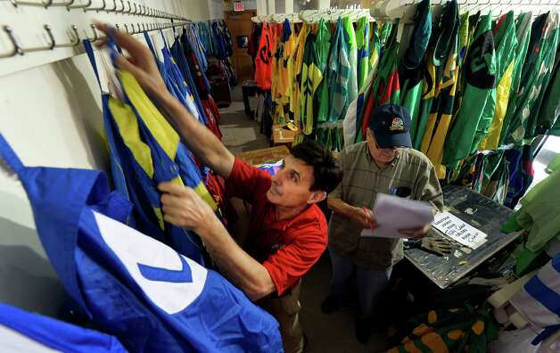 Colors workers Frank Lopez, left and Walter Arce put out the silks for opening day Thursday morning, July 17, 2014, at Saratoga Race Course in Saratoga Springs, N.Y.  (Skip Dickstein / Times Union) Photo: SKIP DICKSTEIN / 00027702A