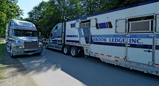 Horse trailers enter and exit as they off load their cargo and head out for more horses Thursday morning, July 17, 2014, at Saratoga Race Course in Saratoga Springs, N.Y.  (Skip Dickstein / Times Union) Photo: SKIP DICKSTEIN / 00027702A