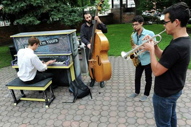 Members of the Dylan Perrillo Orchestra perform with a street piano for the Piano Project on Thursday, July 17, 2014, at Wallenburg Park in Albany, N.Y. From left are David Vandervort, Dylan Perrillo, Adam Siegel and Phil Chow. (Cindy Schultz / Times Union) Photo: Cindy Schultz / 00027827A