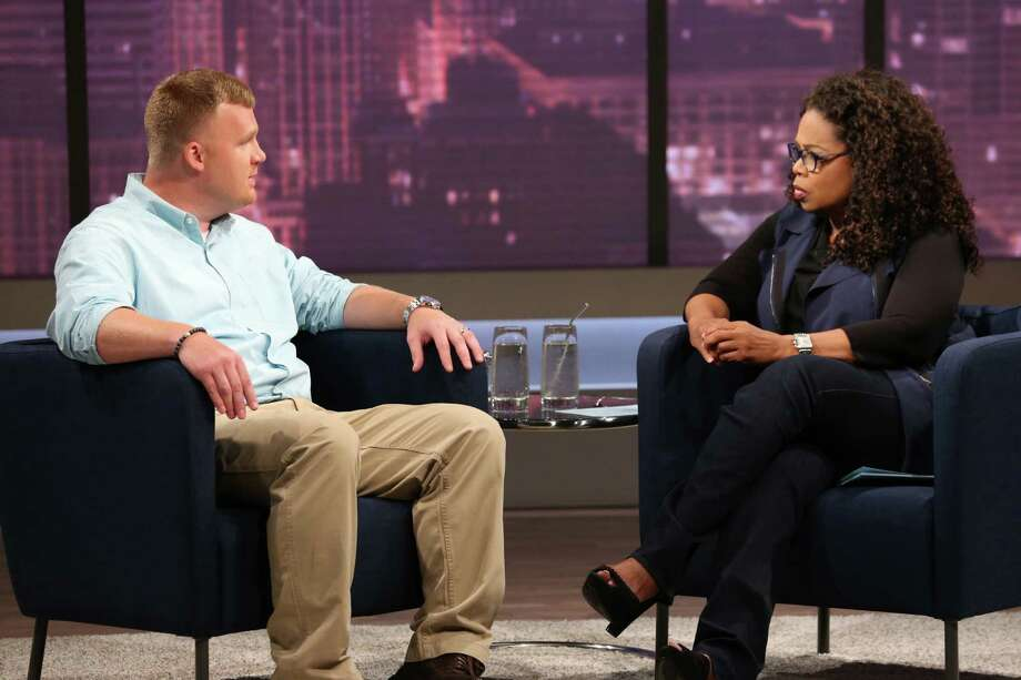 This June 27, 2014 image released by OWN shows Matt Sandusky, the adopted son of former Penn State University assistant football coach Jerry Sandusky, during an interview with Oprah Winfrey, airing on OWN on Thursday, July 17. Matt Sandusky says he enjoyed spending time with the family at their central Pennsylvania home _ except when it came time to go to bed. The Oprah Winfrey Network on Wednesday, July 16, released a clip of Winfrey's interview with Matt Sandusky, who alleges he was sexually abused by his father. (AP Photo/Harpo, Inc., George Burns) MANDATORY CREDIT: GEORGE BURNS ORG XMIT: NYET600 Photo: George Burns / Harpo