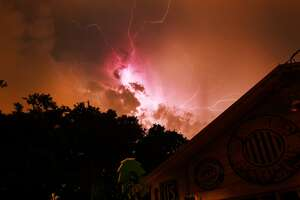 Lightning flashes across the north San Antonio sky Thursday, July 17, 2014.