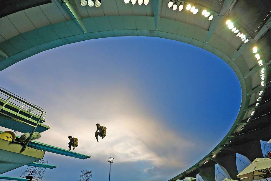 SHANGHAI, CHINA - JULY 17:  Divers practice during day three of the 19th FINA Diving World Cup at the Oriental Sports Center on July 17, 2014 in Shanghai, China.  (Photo by Lintao Zhang/Getty Images) Photo: Lintao Zhang, Getty Images