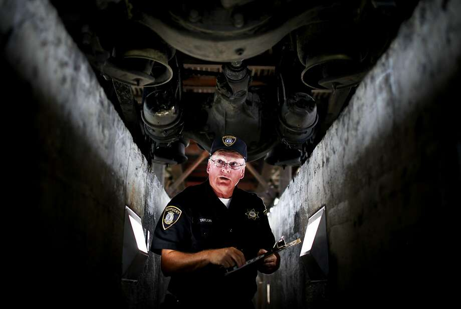 Inspector BIlly Taylor looks at the undercarriage of a tractor-trailer during an inspection at a weigh station in Franklin, Ky., on Thursday, July 17, 2014. (AP Photo/Daily News, Austin Anthony) Photo: Austin Anthony, Associated Press