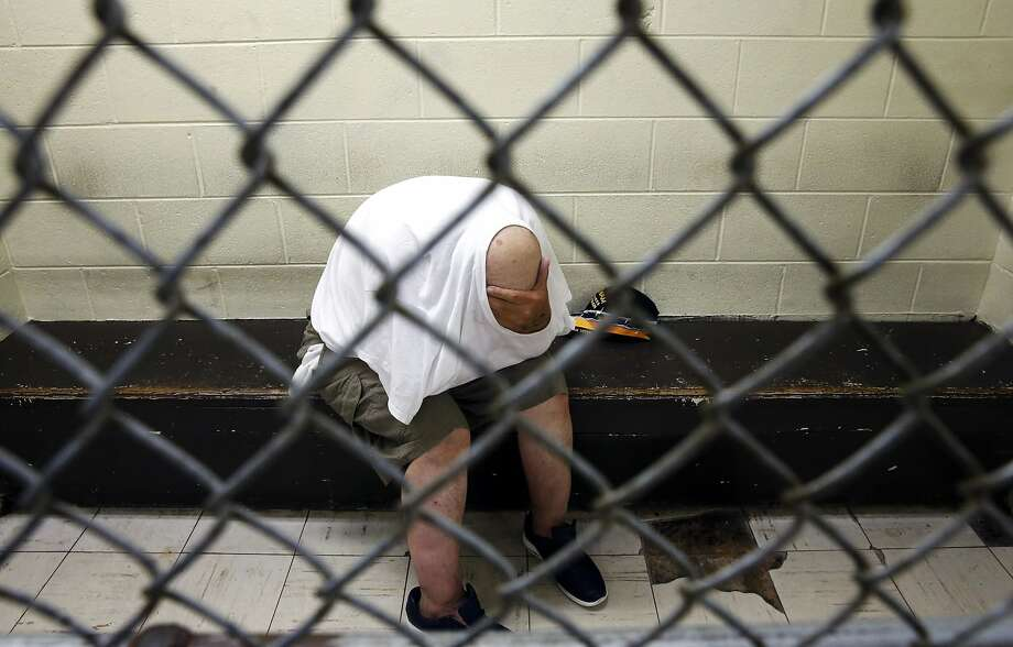 AP10ThingsToSee - In this June 26, 2014 photo, a U.S. veteran with post-traumatic stress, sits in a segregated holding pen at Chicago's Cook County Jail after he was arrested on a narcotics charge. The complex, with more than 10,600 inmates, is one of the country's largest single-site jails. (AP Photo/Charles Rex Arbogast) Photo: Charles Rex Arbogast, Associated Press
