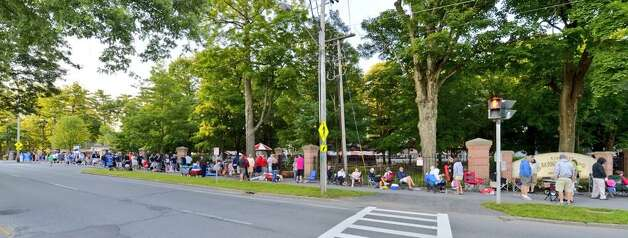 Hundreds up people lined up Friday, July 19, 2014, morning to grab picnic tables for opening day at the Saratoga Race Course. (Skip Dickstein / Times Union)