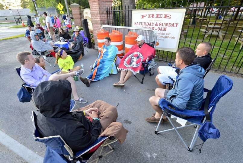 Hundreds up people lined up Friday, July 19, 2014, morning to grab picnic tables for opening day at