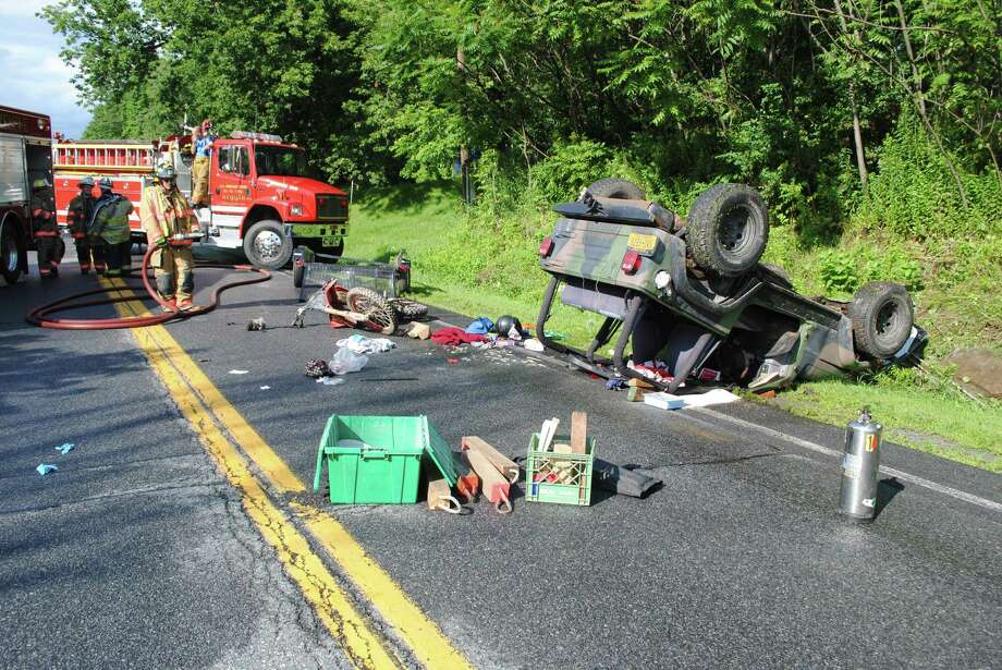 A 21-year-old Fort Edward man was in critical condition after the Jeep he was riding in hit a stone wall and flipped over Thursday, July 17, 2014, on Route 40 in Argyle. (State Police)