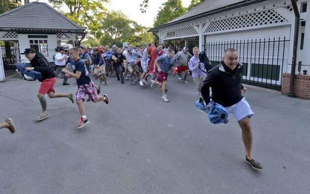 The gates opened at Saratoga Race Course Friday morning and hundreds of people bolted for their picnic tables to enjoy opening day at the track.  (Skip Dickstein / Times Union)