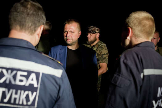 Alexander Borodai, prime minister of the self-proclaimed Donetsk People's Republic that declared its independence from Ukraine, arrives at the scene of the crash site of Malaysia Airlines Flight 17 July 17, 2014 in Grabovo, Ukraine near the Russian border. Flight 17, on its way from Amsterdam to Kuala Lumpur and carrying 295 passengers and crew, is believed to have been shot down by a surface-to-air missile, according to U.S. intelligence officials and Ukrainian authorities quoted in published reports. The area is under control of pro-Russian militias. Photo: Pierre Crom, Getty Images / 2014 Pierre Crom