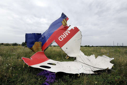A piece of wreckage of the Malaysia Airlines flight MH17 is pictured on July 18, 2014 in Shaktarsk, the day after it crashed. Flight MH17 from Amsterdam to Kuala Lumpur, which US officials believe was hit by a surface-to-air missile over Ukraine, killing all 298 people on board. Photo: DOMINIQUE FAGET, AFP/Getty Images / AFP