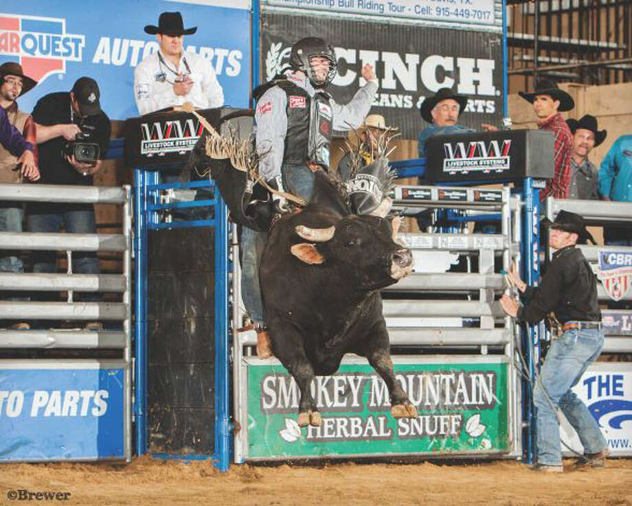 Cody Teel rides a bull named Mayhem earlier this year in Lufkin. Photo courtesy of Todd Brewer