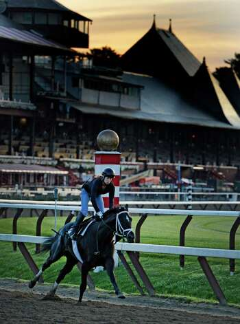 Adele Bellanger works a horse on the main track of the Saratoga Race Course Thursday morning July 17, 2014, the day before opening day of the race meeting at the historic racing venue Saratoga Springs, N.Y.  (Skip Dickstein / Times Union) Photo: SKIP DICKSTEIN, ALBANY TIMES UNION / 00027702A