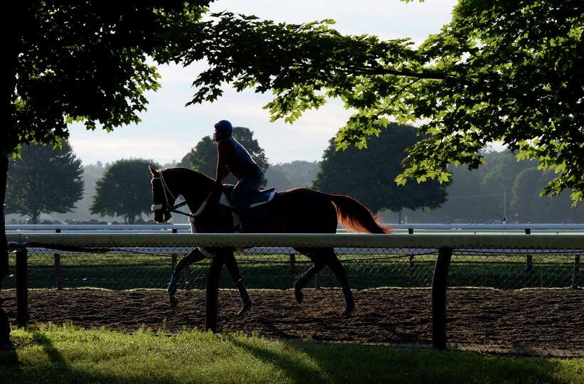 An exercise rider works a horse on the main track of the Saratoga Race Course Thursday morning July