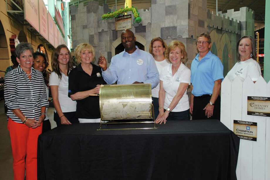 Left to right are Twila Carter, Houston Astros Foundation; Keeley Motton, MHI; Katie Wengler, HomeAid Houston; Bette Moser, HomeAid Houston; James Miller, MHI; Robin Miller, MHI; Lea Pipitone, HomeAid Houston; Mark Welch, David Weekley Homes; and volunteer Vanessa Liles at the drawing for HomeAid Houston's Project Playhouse.