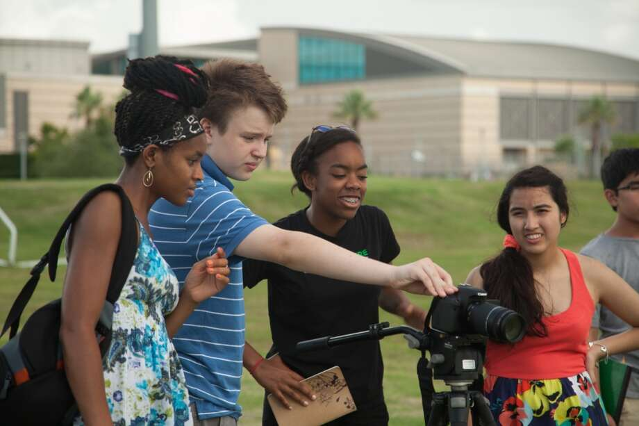 "A student crew films on campus during WonderWorks' ""Moving Pictures"" camp. Photo: Trung Tran"