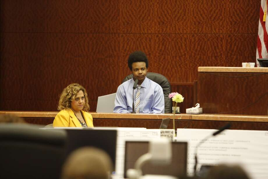 Harlem Lewis takes the stand during his capital murder trial at the Harris County Criminal Courthouse, Friday, July 18, 2014, in Houston. Lewis is accused of fatally shooting Bellaire Police Corporal Jimmie Norman and Terry Taylor, a bystander who had to come to Corporal Norman's aid, on December 24th 2012. He could face the death penalty. Photo: James Nielsen, Houston Chronicle