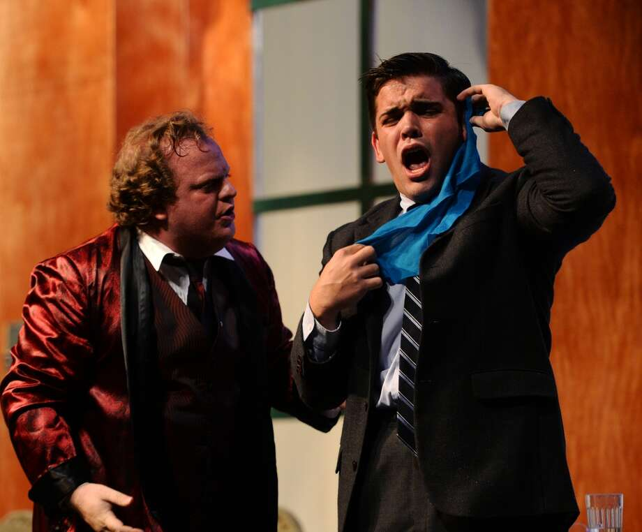 """Max Bialystock, played by Clark Reed, left, tries to comfort the hysterical accountant Leo Bloom, played by Aaron Alford, during a dress rehearsal of """"The Producers"""" on Thursday night. The Lamar State College-Port Arthur theater department, in conjunction with the Port Arthur Little Theatre, is starting a run of Mel Brooks' comedy """"The Producers."""" The play, which follows a pair of producers as they attempt to put on the worst Broadway play ever, will run July 18-20, 25-27, and August 1 and 2.  Photo taken Thursday 7/17/14 Jake Daniels/@JakeD_in_SETX"""
