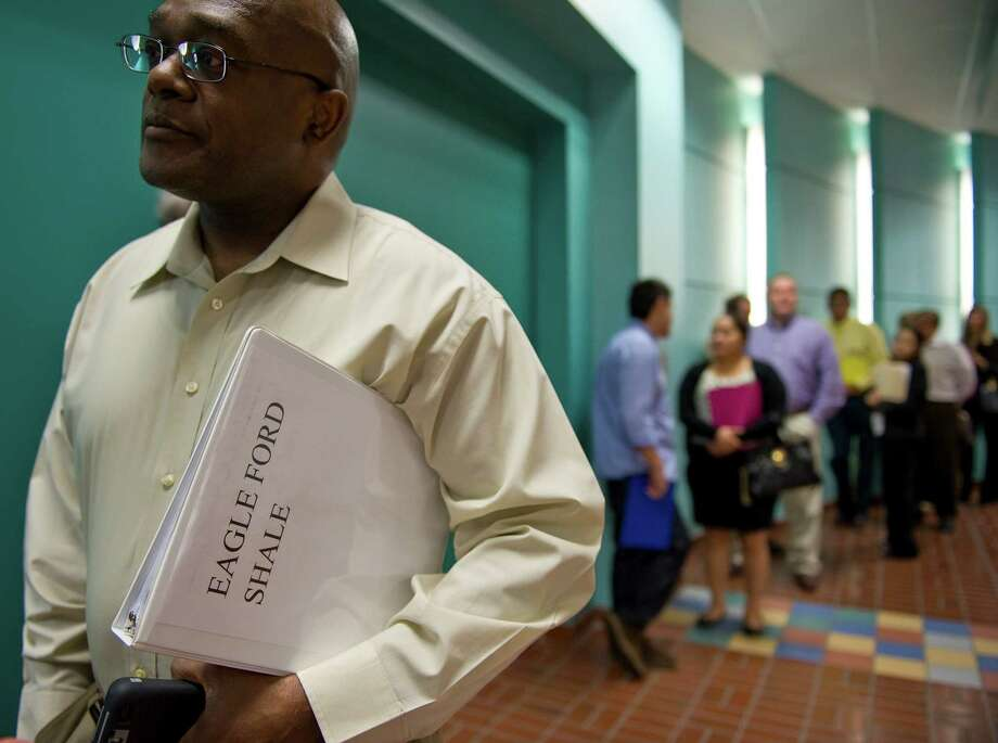 Vint Dockery holds his resume notebook with Eagle Ford Shale printed on the cover while waiting in line for the opening of a job fair last year at the Norris Conference Center in San Antonio. The statewide unemployment rate held steady at a seasonally adjusted 5.1 percent in June, the Texas Workforce Commission said Friday. Photographer: Eddie Seal/Bloomberg News Photo: Eddie Seal, Bloomberg / © 2013 Bloomberg Finance LP