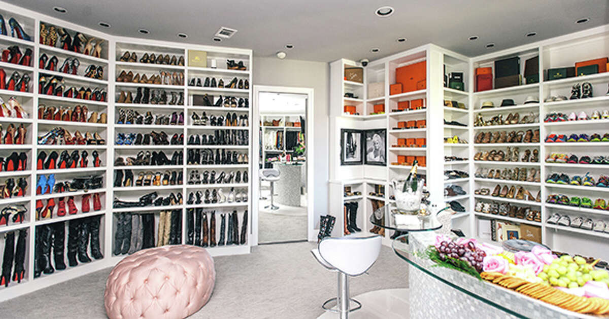 """The closet is an Alladin's Cave of Wonder for lovers of designer labels. Roemer calls it her """"she cave."""""""
