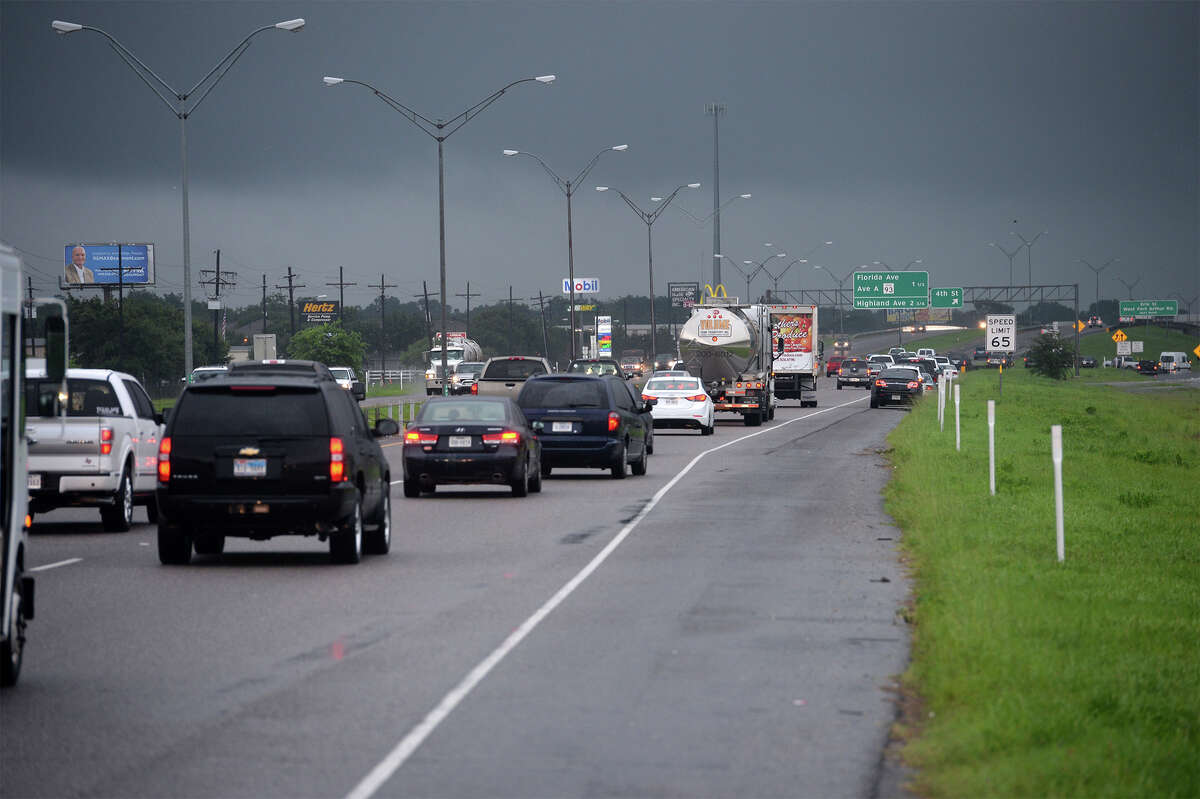 Traffic on Texas 69 caused by flooding. Photo taken Friday, July 18, 2014 Guiseppe Barranco/@spotnewsshooter