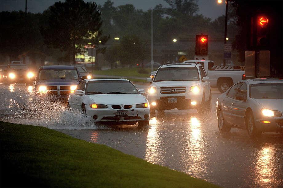 Flooding on Phelan Boulevard. Photo taken Friday, July 18, 2014 Guiseppe Barranco/@spotnewsshooter Photo: Guiseppe Barranco, Photo Editor