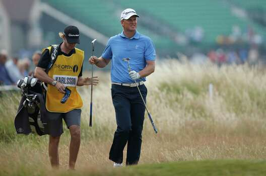 Robert Karlsson of Sweden approaches the 18th green with his caddie his caddie Dan Parratt during the second day of the British Open Golf championship at the Royal Liverpool golf club, Hoylake, England, Friday July 18, 2014. (AP Photo/Alastair Grant) Photo: Alastair Grant, Associated Press / AP