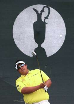 Kiradech Aphibarnrat of Thailand plays a shot on the 3rd hole during the second day of the British Open Golf championship at the Royal Liverpool golf club, Hoylake, England, Friday July 18, 2014. (AP Photo/Peter Morrison) Photo: Peter Morrison, Associated Press / AP