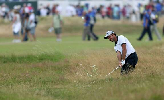 Edoardo Molinari of Italy plays out of the rough on the 2nd hole during the second day of the British Open Golf championship at the Royal Liverpool golf club, Hoylake, England, Friday July 18, 2014. (AP Photo/Peter Morrison) Photo: Peter Morrison, Associated Press / AP