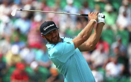 HOYLAKE, ENGLAND - JULY 18:  Dustin Johnson of the United States hits his tee shot on the fourth hole during the second round of The 143rd Open Championship at Royal Liverpool on July 18, 2014 in Hoylake, England. Photo: Matthew Lewis, Getty Images / 2014 Getty Images