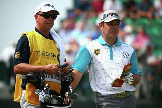 HOYLAKE, ENGLAND - JULY 18:  Louis Oosthuizen of South Africa with his caddie on the fourth hole during the second round of The 143rd Open Championship at Royal Liverpool on July 18, 2014 in Hoylake, England. Photo: Matthew Lewis, Getty Images / 2014 Getty Images