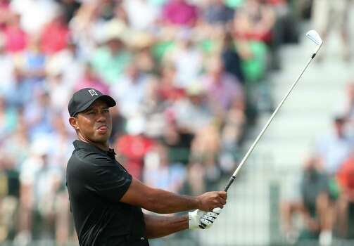 US golfer Tiger Woods watches his shot from the 4th tee during his second round, on day two of the 2014 British Open Golf Championship at Royal Liverpool Golf Course in Hoylake, north west England on July 18, 2014. AFP PHOTO / ANDREW YATESANDREW YATES/AFP/Getty Images Photo: ANDREW YATES, AFP/Getty Images / AFP