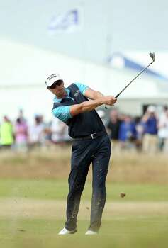 Sweden's Henrik Stenson plays his approach shot to the 4th green during his second round, on day two of the 2014 British Open Golf Championship at Royal Liverpool Golf Course in Hoylake, north west England on July 18, 2014. AFP PHOTO / ANDREW YATESANDREW YATES/AFP/Getty Images Photo: ANDREW YATES, AFP/Getty Images / AFP