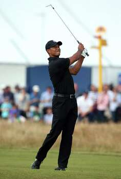 US golfer Tiger Woods plays his approach shot to the 4th green during his second round, on day two of the 2014 British Open Golf Championship at Royal Liverpool Golf Course in Hoylake, north west England on July 18, 2014. AFP PHOTO / ANDREW YATESANDREW YATES/AFP/Getty Images Photo: ANDREW YATES, AFP/Getty Images / AFP