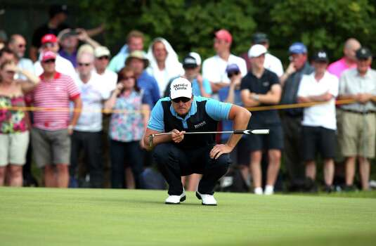 Sweden's Henrik Stenson lines up his putt on the 4th green during his second round, on day two of the 2014 British Open Golf Championship at Royal Liverpool Golf Course in Hoylake, north west England on July 18, 2014. AFP PHOTO / ANDREW YATESANDREW YATES/AFP/Getty Images Photo: ANDREW YATES, AFP/Getty Images / AFP