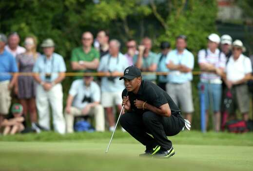 US golfer Tiger Woods lines up his putt on the 4th green during his second round, on day two of the 2014 British Open Golf Championship at Royal Liverpool Golf Course in Hoylake, north west England on July 18, 2014. AFP PHOTO / ANDREW YATESANDREW YATES/AFP/Getty Images Photo: ANDREW YATES, AFP/Getty Images / AFP