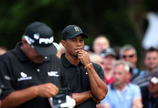 US golfer Tiger Woods looks on from the 5th tee during his second round, on day two of the 2014 British Open Golf Championship at Royal Liverpool Golf Course in Hoylake, north west England on July 18, 2014. AFP PHOTO / ANDREW YATESANDREW YATES/AFP/Getty Images Photo: ANDREW YATES, AFP/Getty Images / AFP