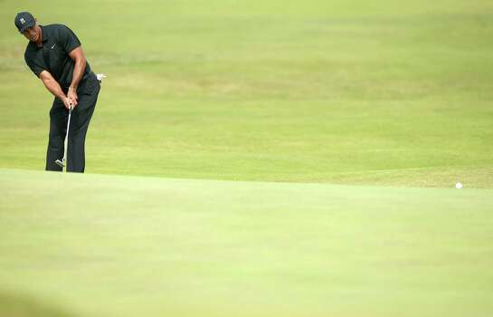 US golfer Tiger Woods putts on the 5th green during his second round, on day two of the 2014 British Open Golf Championship at Royal Liverpool Golf Course in Hoylake, north west England on July 18, 2014. AFP PHOTO / ANDREW YATESANDREW YATES/AFP/Getty Images Photo: ANDREW YATES, AFP/Getty Images / AFP