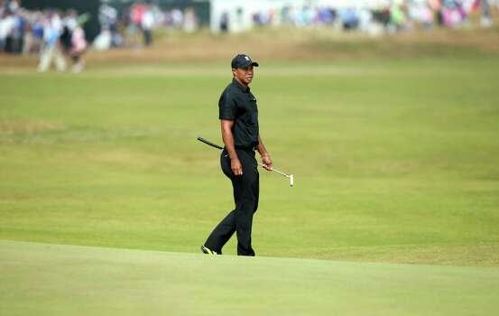 US golfer Tiger Woods walks on the 5th green during his second round, on day two of the 2014 British Open Golf Championship at Royal Liverpool Golf Course in Hoylake, north west England on July 18, 2014. AFP PHOTO / ANDREW YATESANDREW YATES/AFP/Getty Images Photo: ANDREW YATES, AFP/Getty Images / AFP