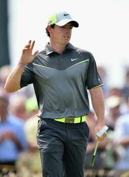 HOYLAKE, ENGLAND - JULY 18:  Rory McIlroy of Northern Ireland acknowledges the crowd during the second round of The 143rd Open Championship at Royal Liverpool on July 18, 2014 in Hoylake, England. Photo: Stuart Franklin, Getty Images / 2014 Getty Images