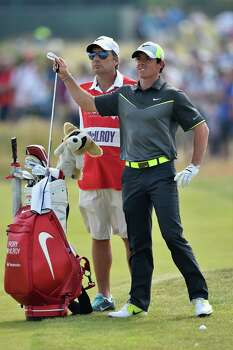 HOYLAKE, ENGLAND - JULY 18:  Rory McIlroy of Northern with his caddie J.P. Fitzgerald during the second round of The 143rd Open Championship at Royal Liverpool on July 18, 2014 in Hoylake, England. Photo: Stuart Franklin, Getty Images / 2014 Getty Images