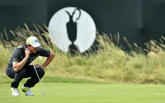 HOYLAKE, ENGLAND - JULY 18:  Rory McIlroy of Northern Ireland lines up a putt on the third green during the second round of The 143rd Open Championship at Royal Liverpool on July 18, 2014 in Hoylake, England. Photo: Stuart Franklin, Getty Images / 2014 Getty Images