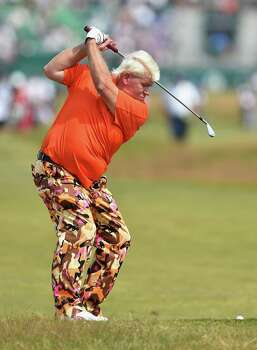 HOYLAKE, ENGLAND - JULY 18:  John Daly of the United States hits a shot on the 18th hole during the second round of The 143rd Open Championship at Royal Liverpool on July 18, 2014 in Hoylake, England. Photo: Stuart Franklin, Getty Images / 2014 Getty Images