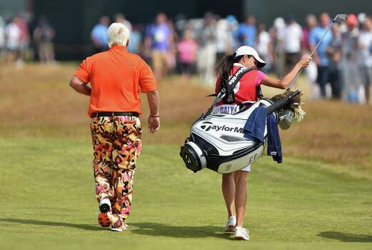 HOYLAKE, ENGLAND - JULY 18:  John Daly of the United States walks on the 18th hole with his girlfriend/caddie Anna Cladakis during the second round of The 143rd Open Championship at Royal Liverpool on July 18, 2014 in Hoylake, England. Photo: Stuart Franklin, Getty Images / 2014 Getty Images